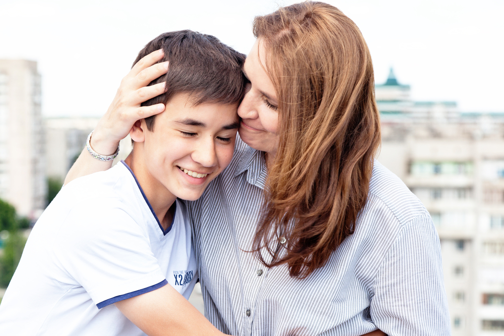 5 Ways To Tell Your Teen They're Loved Without Speaking