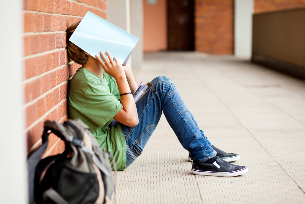 6 Reasons Why Your Teen Hates School (And What To Do About It)